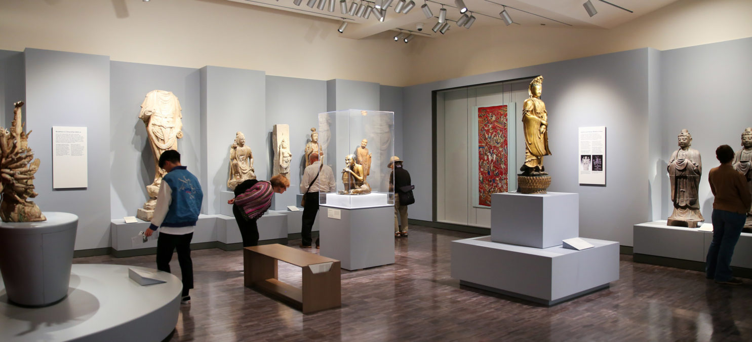 Museum visitors look at artwork in the China galleries.